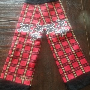 Red and black skull leg warmers
